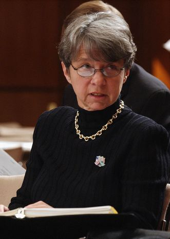** FILE ** In this Oct. 8, 2002, file photo, Mary Jo White, former U.S. Attorney for the Southern District of New York, appears on Capitol Hill in Washington. A White House official says President Barack Obama on Thursday will nominate White as chair of the Securities and Exchange Commission (SEC). (AP Photo/Dennis Cook, File)