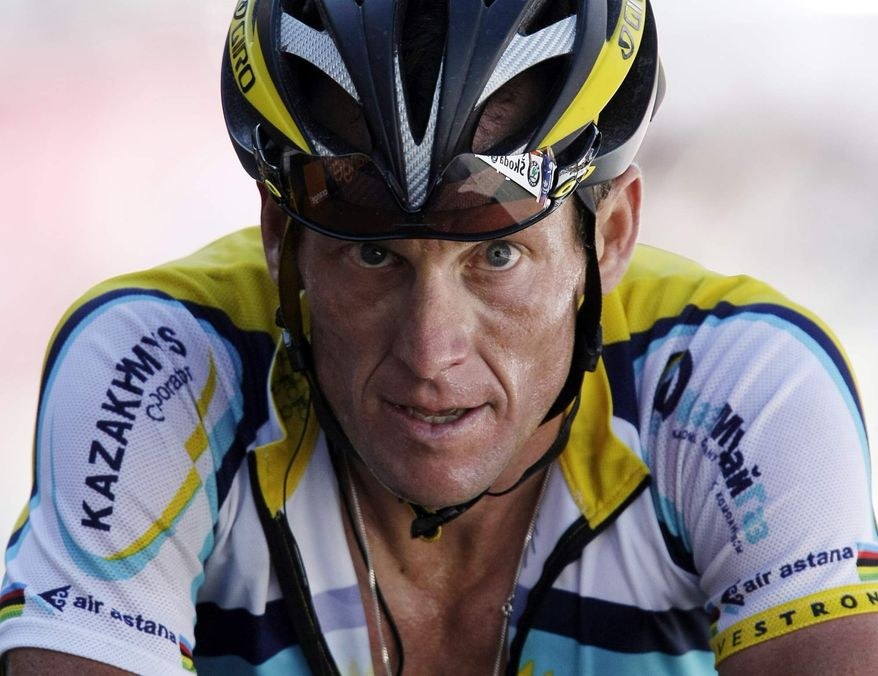 ** FILE ** In this July 19, 2009, file photo, Lance Armstrong crosses the finish line during the 15th stage of the Tour de France cycling race in Verbier, Switzerland. Armstrong confessed to using performance-enhancing drugs to win the Tour de France during a taped interview with Oprah Winfrey that aired Thursday, Jan. 17, 2013, reversing more than a decade of denial. (AP Photo/Laurent Rebours, File)