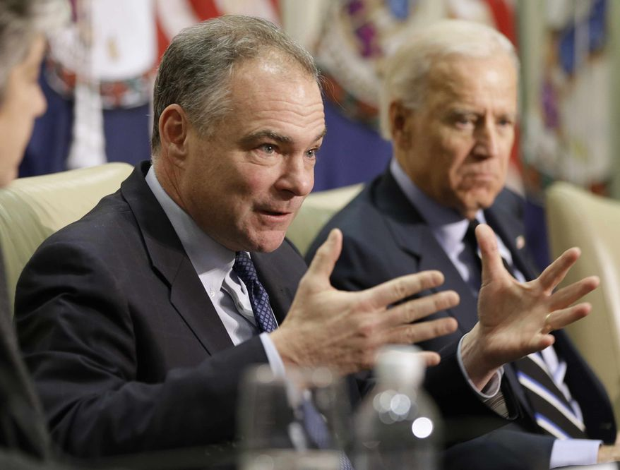 ** FILE ** Sen. Tim Kaine, Virginia Democrat, left, accompanied by Vice President Joseph R. Biden, gestures during a roundtable discussion on gun violence, Friday, Jan. 25, 2013, at Virginia Commonwealth University in Richmond, Va. The panelists included officials who worked on the aftermath of the Virginia Tech shootings. (AP Photo/Steve Helber)