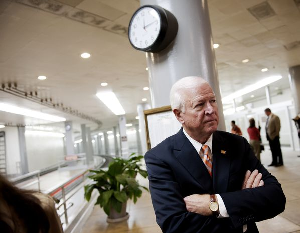 **FILE** Senate Intelligence Committee Vice Chairman Sen. Saxby Chambliss, Georgia Republican, waits to speak with reporters on Capitol Hill in Washington on Nov. 16, 2012. (Associated Press)