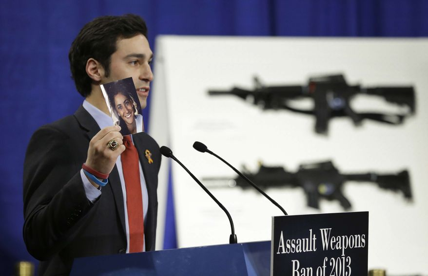Omar Samaha, holds a picture of his sister Reema Samaha, who was killed in the Virginia Tech shootings, Thursday, Jan. 24, 2013, during a news conference on Capitol Hill in Washington to introduce legislation on assault weapons and high-capacity ammunition feeding devices. (AP Photo/Manuel Balce Ceneta)