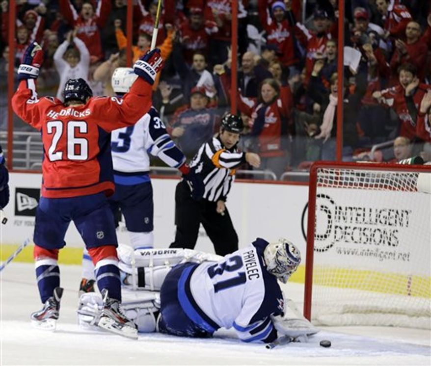 Washington Capitals forward Matt Hendricks (26) celebrates his goal past Winnipeg Jets goalie Ondrej Pavelec (31) from the Czech Republic, in the first period of an NHL hockey game Tuesday, Jan. 22, 2013 in Washington. (AP Photo/Alex Brandon)