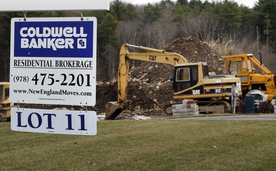 **FILE** A sign hangs Dec. 20, 2012, in North Andover, Mass., where a house is under construction. (Associated Press)