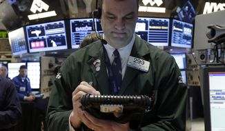 Trader William Lawrence works on the floor of the New York Stock Exchange on Jan. 25, 2013. Stocks are opening higher on Wall Street ahead of what is expected to be more upbeat data on housing from the government. (Associated Press)