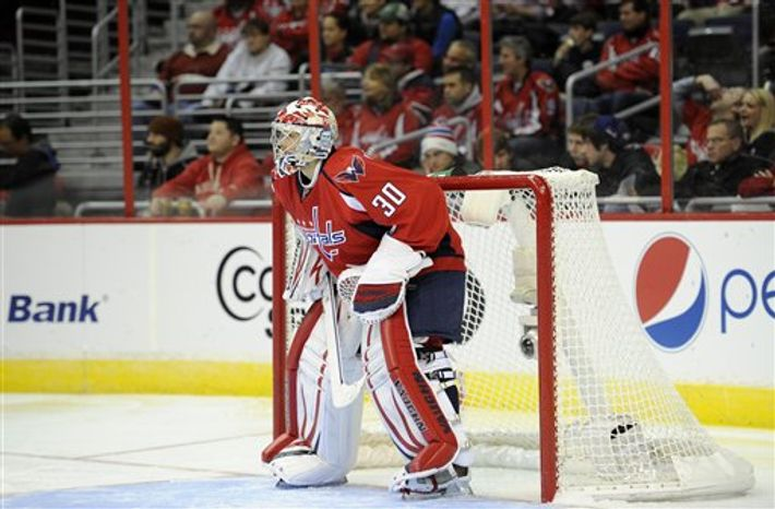 Washington Capitals goalie Michal Neuvirth (30), of the Czech Republic, looks on during the third period of an NHL hockey game against the Montreal Canadiens, Thursday, Jan. 24, 2013, in Washington. The Canadiens won 4-1.(AP Photo/Nic