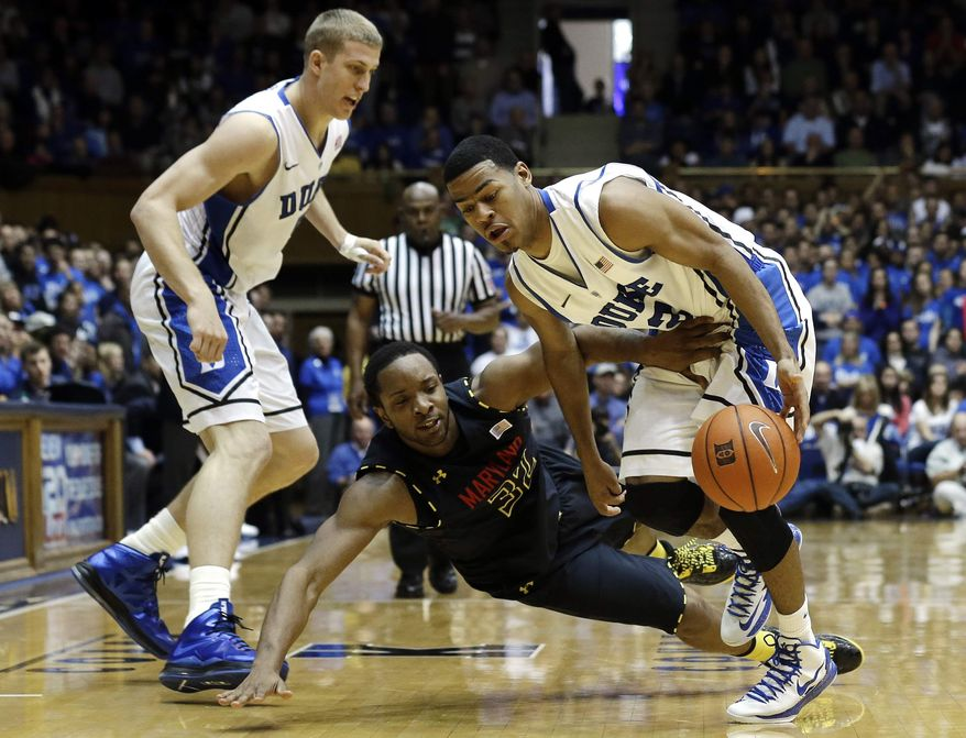 Duke's Mason Plumlee, left, and Quinn Cook, right, struggle with Maryland's Dez Wells during the second half of an NCAA college basketball game in Durham, N.C., Saturday, Jan. 26, 2013. Duke won 84-64. (AP Photo/Gerry Broome)