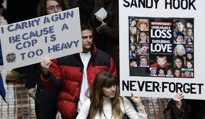 ** FILE ** Gun rights and gun control advocates demonstrate in the Pennsylvania Capital building Wednesday, Jan. 23, 2013, in Harrisburg, Pa. (AP Photo/Matt Rourke);