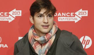 "** FILE ** Actor Ashton Kutcher, who portrays Apple's Steve Jobs in the film ""Jobs,"" poses at its premiere during the 2013 Sundance Film Festival on Friday, Jan. 25, 2013, in Park City, Utah. (Danny Moloshok/Invision/AP)"