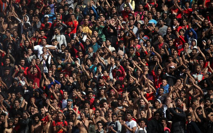 Fans of the Egyptian soccer club Al-Ahly celebrate in Cairo on Saturday, Jan. 26, 2013, after a court returned 21 death penalties in last year's soccer violence, which left 74