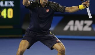 Serbia's Novak Djokovic celebrates his win over Britain's Andy Murray in the men's final at the Australian Open tennis championship in Melbourne, Australia, Sunday, Jan. 27, 2013. (AP Photo/Dita Alangkara)