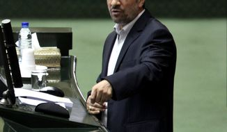 Iranian President Mahmoud Ahmadinejad speaks in the parliament in Tehran on Wednesday, Jan. 16, 2013. (AP Photo/Vahid Salemi)
