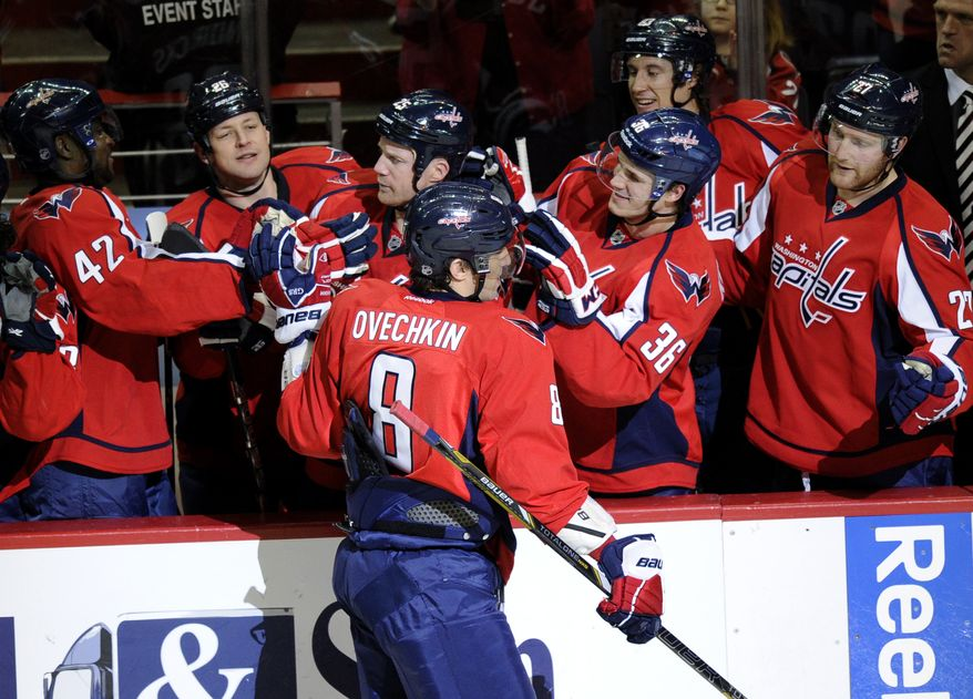 Washington Capitals left wing Alex Ovechkin (8), of Russia, celebrates his goal against the Buffalo Sabres during the third period of an NHL hockey game, Sunday, Jan. 27, 2013, in Washington. The Capitals won 3-2. (AP Photo/Nick Wass)