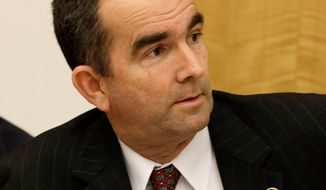 A bid by state Sen. Ralph Northam (right), Norfolk Democrat, to make pre-abortion ultrasounds optional was turned back by state Sen. Stephen H. Martin during a Privileges and Elections Committee special meeting on Monday. (Associated Press)