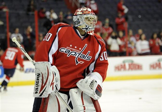 Washington Capitals goalie Michal Neuvirth (30), of the Czech Republic, looks on during warmups before an NHL hockey game against the Montreal Canadiens, Thursday, Jan. 24, 2013, in Washington. (AP Photo/Nick Wass