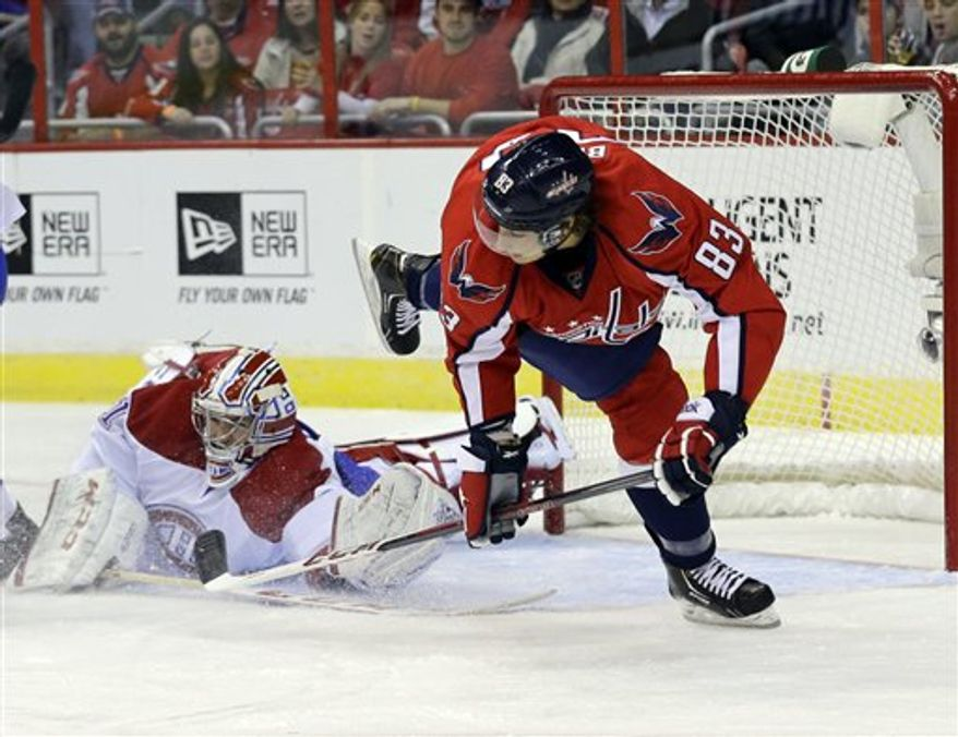 Washington Capitals center Jay Beagle (83) dives after his shot was blocked by Montreal Canadiens goalie Carey Price (31) in the first period of an NHL hockey game on Thursday, Jan. 24, 2013, in Washington. (AP Photo/Alex Brandon)