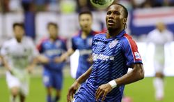 FILE - In this Aug. 4, 2012 file photo, Shanghai Shenhua's Didier Drogba controls the ball during a soccer match against Hangzhou Greentown at Hongkou Football Stadium in Shanghai. (AP Photo/Eugene Hoshiko, File)