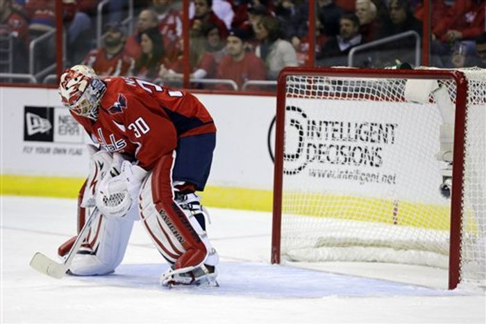 Washington Capitals goalie Michal Neuvirth (30), from the Czech Republic, pauses after allowing a goal in the second period of an NHL hockey game against the Montreal Canadiens, Thursday, Jan. 24, 2013, in Washington. Neuvirth allowed four goals in the second period and the Canadiens won 4-1. (AP Photo/Alex Brandon)