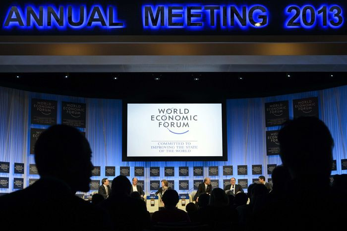 Participants listen a panel session in the Congress Hall the last day of the 43rd Annual Meeting of the World Economic Forum, WEF, in Davos, Switzerland, Saturday, Jan. 26, 2013. (AP Phot