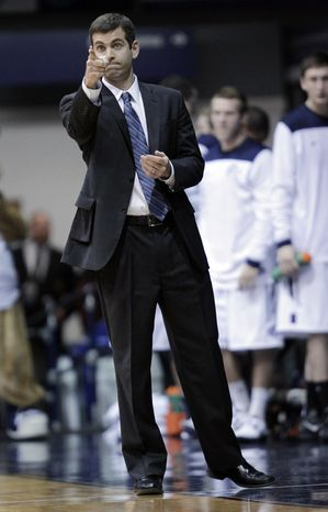 Butler coach Brad Stevens points at the basket during the first half of Butler's 64-63 win in an NCAA college basketball game against Gonzaga on Saturday, Jan. 19,