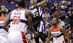 Sacramento Kings guard Isaiah Thomas (22) shoots over the Washington Wizards frontcourt of Nene (left), Emeka Okafor (50) and Martell Webster (9) in the first half of the Kings' 96-94 win on Jan. 28, 2013, in Washington. (Associated Press)