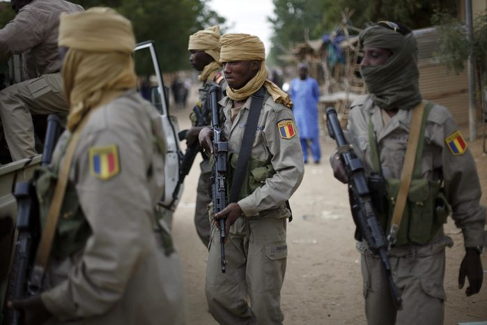 Chadian soldiers patrol the streets of Gao, northern Mali, on Jan. 28, 2013. After securing a strategic bridge and the airport in Gao the day before, Malian troops backed by French helicopters and paratroopers entered the fabled city of Timbuktu, north of Gao, on Monday after al Qaeda-linked militants fled into the desert. (Associated Press)