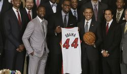 President Obama honors the NBA champions Miami Heat basketball team in the East Room at the White House on Jan. 28, 2013. Pictured in the front row with the president are (from left) Chris Bosh, Dwyane Wade, LeBron James and coach Erik Spoelstra. (Associated Press)