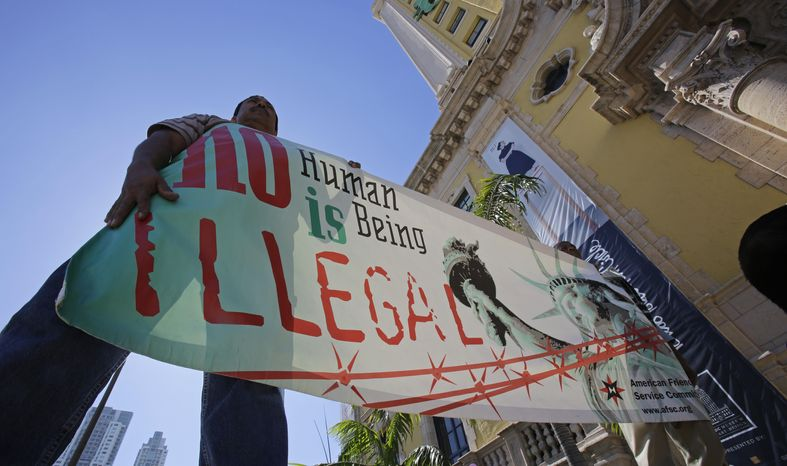 "**FILE** Immigration reform activists hold a sign in front of Freedom Tower in downtown Miami on Jan. 28, 2013. The Florida Immigrant Coalition, together with other immigrant families and community organizations, have initiated the ""Di Que Si!&q"