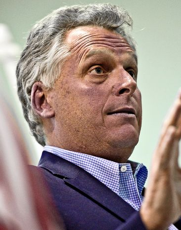 Terry McAuliffe speaks during the Falls Church City Democratic Committee fundraising dinner at the Falls Church Community Center in Falls Church, Va., on Sunday, April 3, 2011. (The Washington Times)