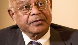 **FILE** Natwar M. Gandhi, chief financial officer of the District of Columbia, responds to questions during an interview in Washington on April 9, 2012. (The Washington Times)