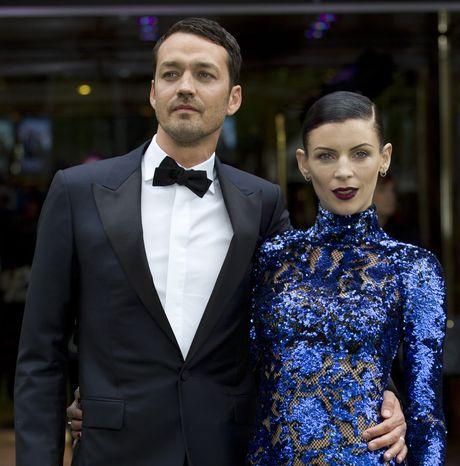 """** FILE ** Rupert Sanders, director of """"Snow White and the Huntsman,"""" and actress-model Liberty Ross, his wife, attend the world premiere of the film at a cinema in central London on Monday, May 14, 2012. (AP Photo/Alastair Grant, File)"""