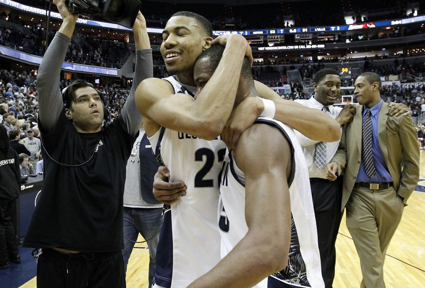 Georgetown forward Otto Porter Jr. (22) celebrates with guard Jabril Trawick (55) after defeating No. 5 Louisville 53-51 in am NCAA college basketball game, Saturday, Jan. 26, 2013, in Washington. (AP Photo/Alex Brandon)