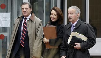 Former Michigan Supreme Court Justice Diane Hathaway leaves federal court in Ann Arbor, Mich., on Tuesday, Jan. 29, 2013, with her husband, Michael Kingsley (left), and attorney Steve Fishman after pleading guilty to bank fraud. (AP Photo/Carlos Osorio)