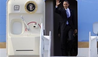 President Obama waves as he exits Air Force One upon his arrival at McCarran International Airport Tuesday, Jan. 29, 2013 in Las Vegas. (Associated Press)