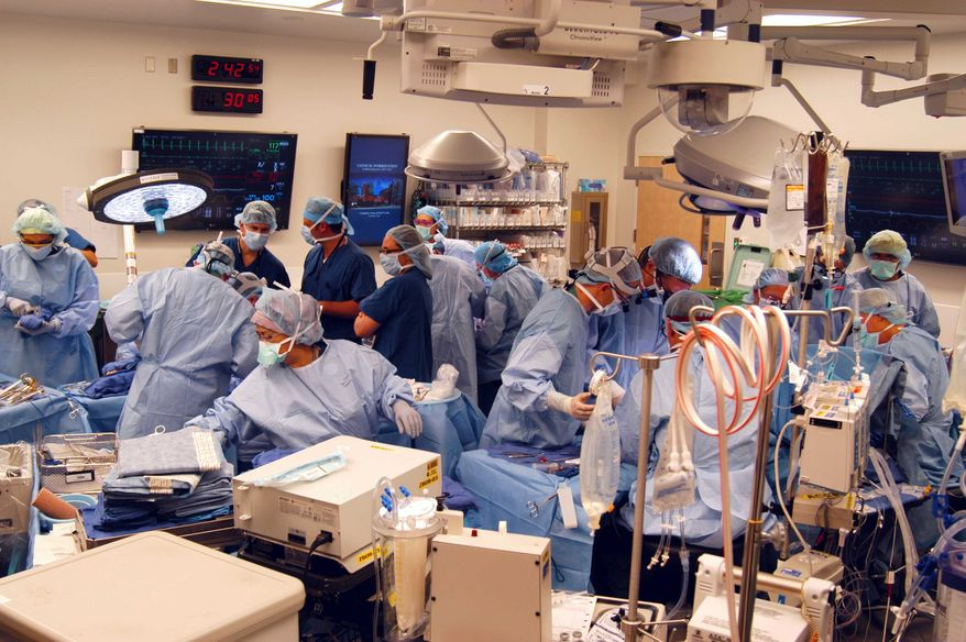 In a Dec. 18, 2012, photo provided by Johns Hopkins Medical, a surgical team at Johns Hopkins Hospital in Baltimore works on a double-arm transplant for U.S. Army infantryman Brendan Marroco, 26, who lost all four limbs in Iraq. The transplants are only the seventh double-hand or double-arm transplant ever conducted in the United States. The infantryman was injured by a roadside bomb in 2009. (AP Photo/Johns Hopkins Medical)