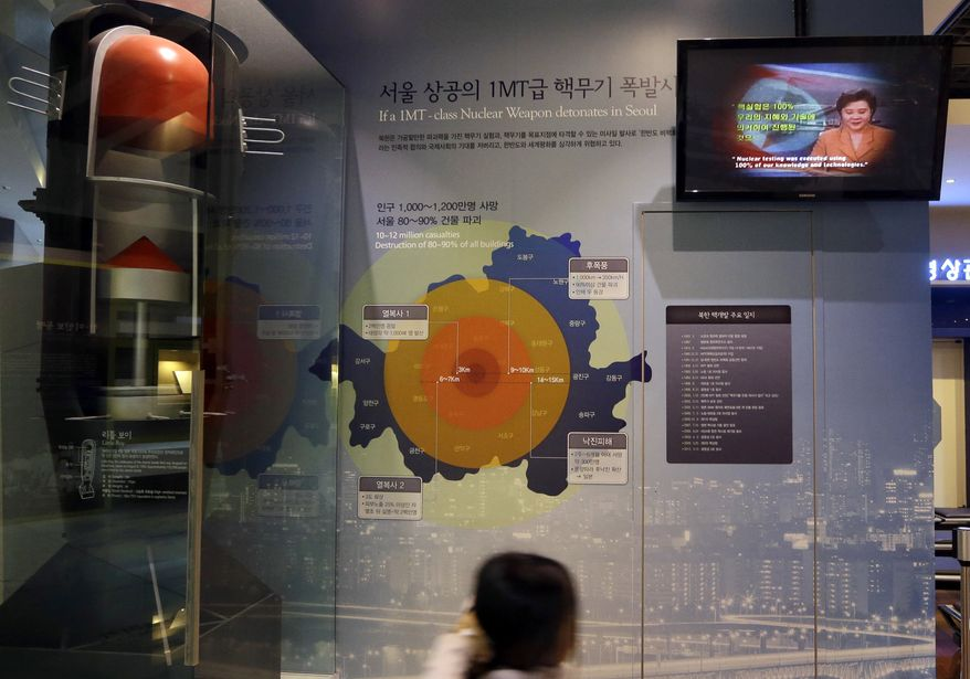 A girl looks at a display on the impact of supposed nuclear attack on South Korea at the Korea War Memorial Museum in Seoul, on Tuesday, Jan. 29, 2013. North Korea appears all set to detonate an atomic device, but confirming the explosion when it takes place will be virtually impossible for outsiders, specialists said Tuesday. (AP Photo/Lee Jin-man)