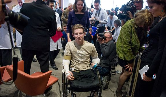 Iraq war veteran Brendan Marrocco departs after a press conference after a surgical team lead by Johns Hopkins physicians who successfully performed the hospitalís first bilateral arm transplant on him, Baltimore, Md., Tuesday, January 29, 2013. Marrocco, who lost all four limbs from a bomb outside Baghdad, Iraq., is expected to slowly develop control over his new arms over the next year and a half. (Andrew Harnik/The Washington Times)