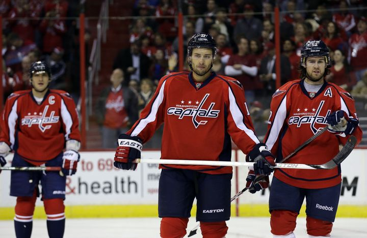 Washington Capitals left wing Alex Ovechkin (8) from Russia, left wing Wojtek Wolski (17) from Poland and defenseman Mike Green (52) pause in the second period of an NHL hockey game against the Montreal Canadiens Thursday, Jan. 24, 2013 in Washington. (AP Photo/Alex Brandon)