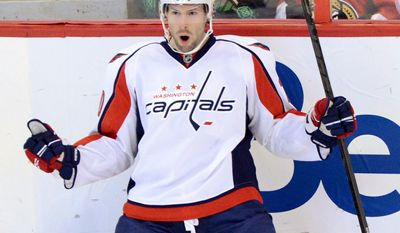 Washington Capitals' Troy Brouwer celebrates his goal against the Ottawa Senators during the first period of an NHL hockey game at the Scotia Bank Place in Ottawa, Ontario, on Tuesday, Jan. 29, 2013. (AP Photo/The Canadian Press, Sean Kilpatrick)