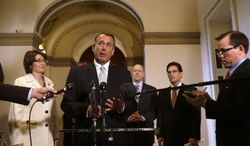 **FILE** House Speaker John Boehner (center), Ohio Republican, speaks Jan. 23, 2013, during a news conference on Capitol Hill to discuss the debt limit. The House overwhelmingly passed a bill earlier in the day to permit the government to borrow enough money to avoid a first-time default for at least four months, defusing a looming crisis setting up a springtime debate over taxes, spending and the deficit. From left are Reps. Cathy McMorris Rodgers, Washington Republican; Dave Camp, Michigan Republican and House Ways and Means Committee Chairman; and House Majority Leader Eric Cantor, Virginia Republican. (Associated Press)