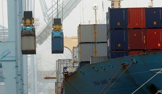 **FILE** Cargo ships are unloaded in December at the Port of Los Angeles. (Associated Press)