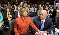 ** FILE ** Former Rep. Gabrielle Giffords, who was seriously injured in a mass shooting that killed six people in Tucson, Ariz., in 2011, sits with her husband, Mark Kelly, a retired astronaut, on Capitol Hill in Washington on Wednesday, Jan. 30, 2013, before speaking before the Senate Judiciary Committee hearing on what lawmakers should do to curb gun violence in the wake of the December shooting rampage that killed 20 schoolchildren in Newtown, Conn. (AP Photo/J. Scott Applewhite)
