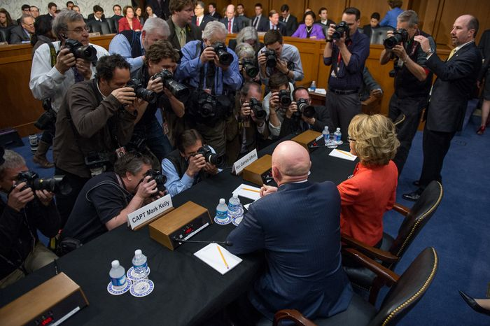 Former Rep. Gabrielle Giffords (right), with her husband, Mark Kelly (bottom center), gives a brief statement on gun violence before the Senate Judiciary Committee in the Hart Senate Office Building on Capitol Hill in Washington on Wednesday, Jan. 30, 2013. (Andrew Harnik/The Washington Times)