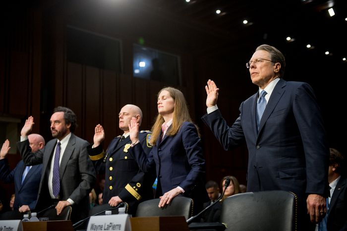 Wayne LaPierre (right), executive vice president and CEO of the National Rifle Association, is sworn in with other panelists before giving testimony on gun control before the Senate Judiciary Committee in the Hart Senate Office Building on Capitol Hill in Washington on Wednesday, Jan. 30, 2013. (Andrew Harnik/The Washington Times)