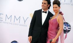 ** FILE ** Actress Ashley Judd and her husband, race car driver Dario Franchitti, arrive at the 64th Primetime Emmy Awards at the Nokia Theatre in Los Angeles on Sunday, Sept. 23, 2012. (Matt Sayles/Invision/AP)