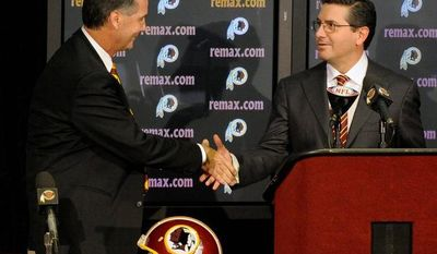 Peter Lockley/The Washington Times Bruce Allen (left) shakes hands with Washington Redskins owner Dan Snyder as he is introduced Thursday at Redskin Park as the team's new executive vice president and general manager.
