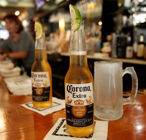 ** FILE ** This Jan. 31, 2013, file photo shows two Corona beers. (Associated Press)