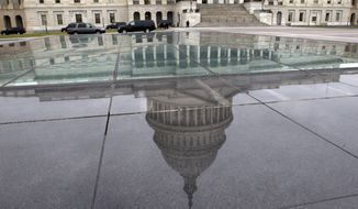The dome of the Capitol is reflected in a skylight of the Capitol Visitor's Center in Washington on  Jan. 1, 2013. (Associated Press) ** FILE **