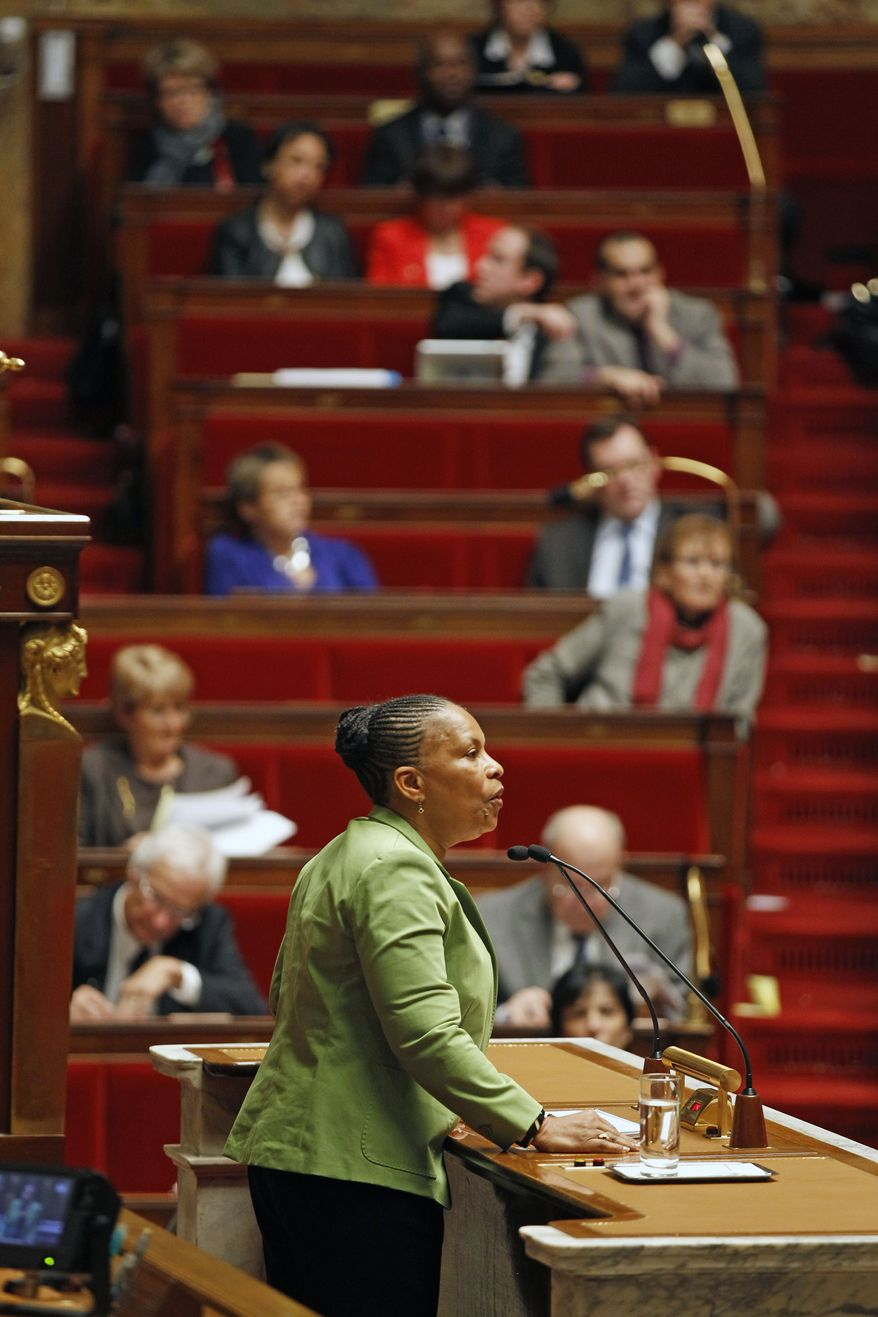 French Justice Minister Christiane Taubira speaks on the first day of debate at the French National Assembly on the government plan to legalize same-sex marriage and adoption for same-sex couples, in Paris on Tuesday, Jan. 29, 2013. (AP Photo/Remy de la Mauviniere)