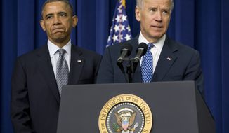 ** FILE ** President Obama listens as Vice President Joseph R. Biden speaks Jan. 16, 2013, at the White House about proposals to reduce gun violence. (Associated Press)
