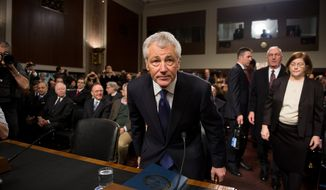 Former Sen. Chuck Hagel arrives on Capitol Hill in Washington on Thursday, Jan. 31, 2013, to testify before the Senate Armed Services Committee on his confirmation to be the next secretary of defense. (Andrew Harnik/The Washington Times)
